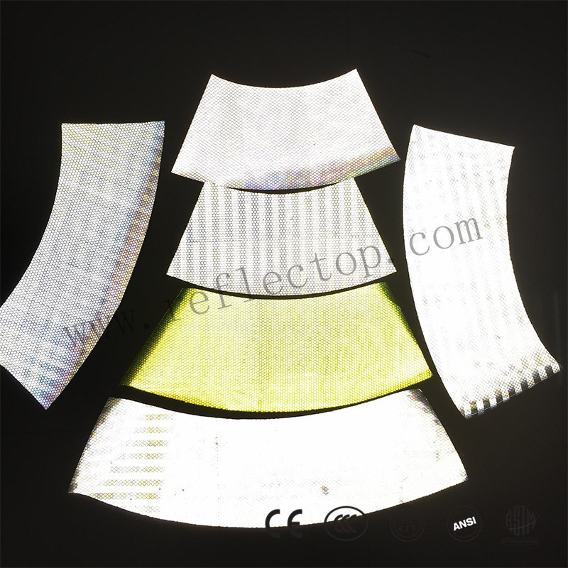 Prismatic reflective film for cone sleeve